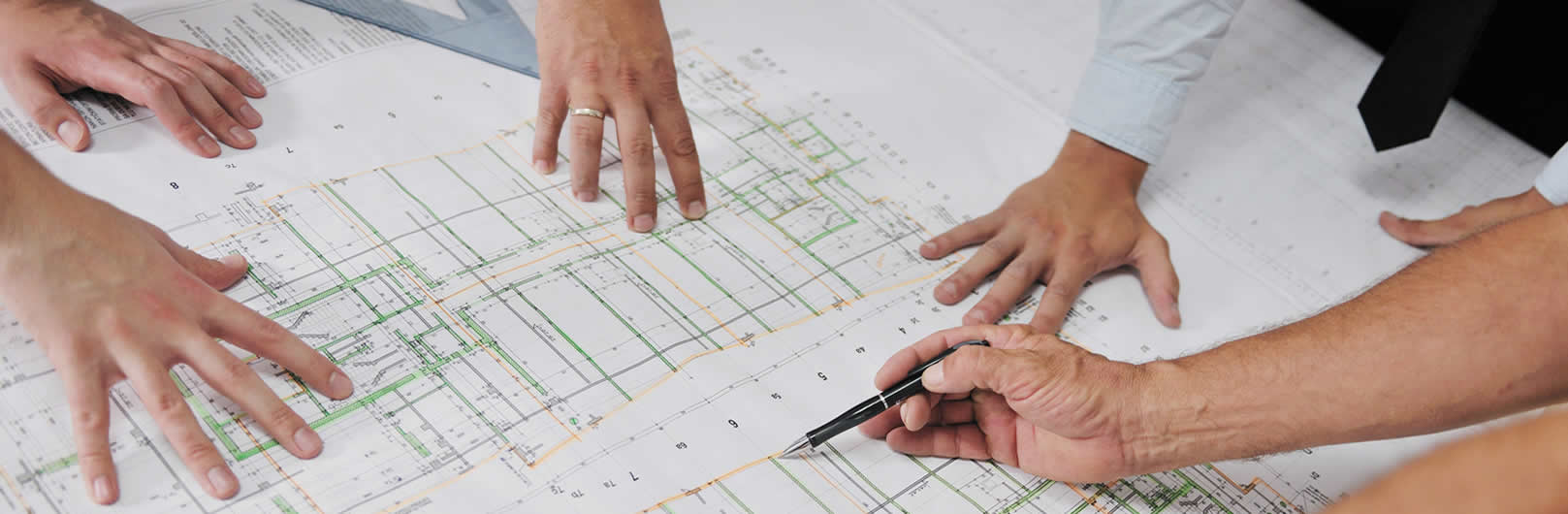 Consulting Engineers with pencils looking over a drawing